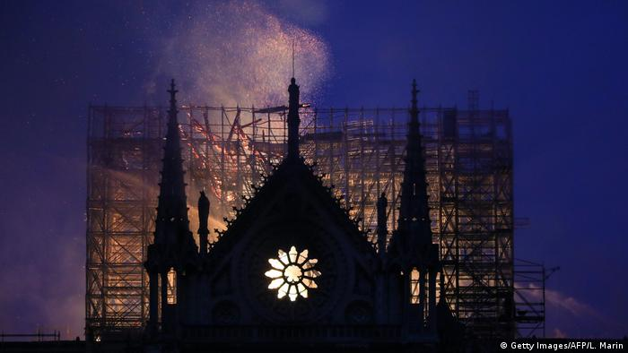 Smoke and flames rise during a fire at the landmark Notre-Dame Cathedral in central Paris (Getty Images/AFP/L. Marin)