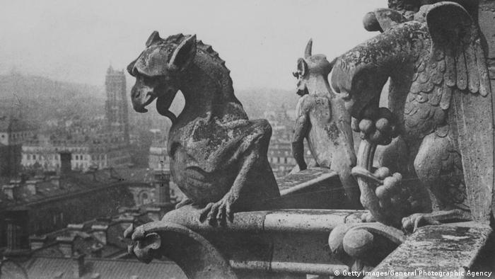 A gargoyle on notre Dame looks out on Paris (Getty Images/General Photographic Agency)