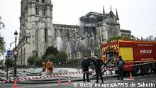 Firefighters continue to secure Notre-Dame Cathedral in Paris on April 16, 2019, in the aftermath of a fire that caused its spire to crash to the ground. - Crowds of stunned Parisians and tourists -- some crying, others offering prayers -- watched in horror in central Paris on April 15 night as firefighters struggled for hours to extinguish the flames engulfing the Notre-Dame Cathedral. (Photo by STEPHANE DE SAKUTIN / AFP) (Photo credit should read STEPHANE DE SAKUTIN/AFP/Getty Images)