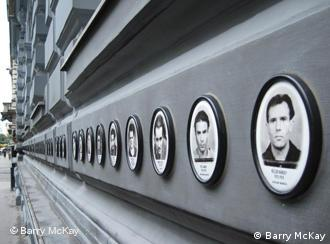 Row of photos on the exterior of the museum, depicting victims of the Hungarian State Security Authority