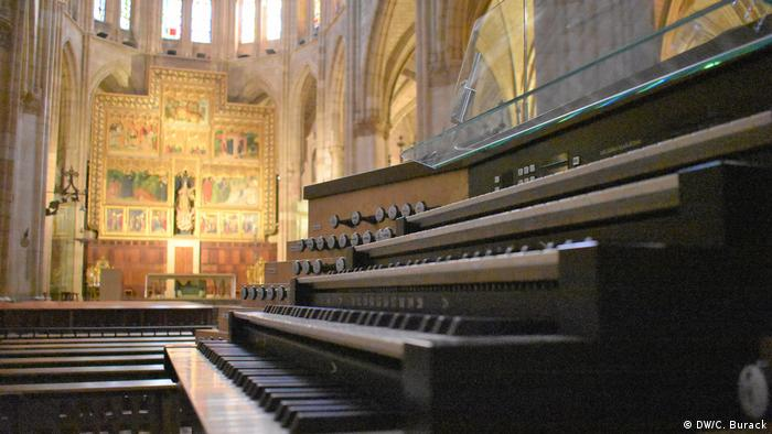 organ keyboards are seen in front of an altarpiece (DW/C. Burack)