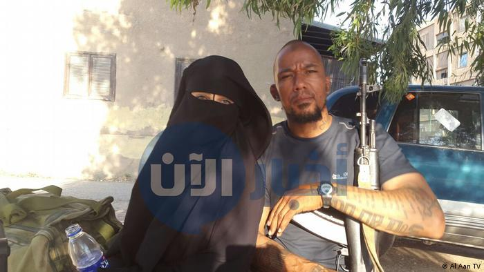 This picture supposedly shows Omaima A with Dennis Cuspert inside IS territory. (Al Aan TV)