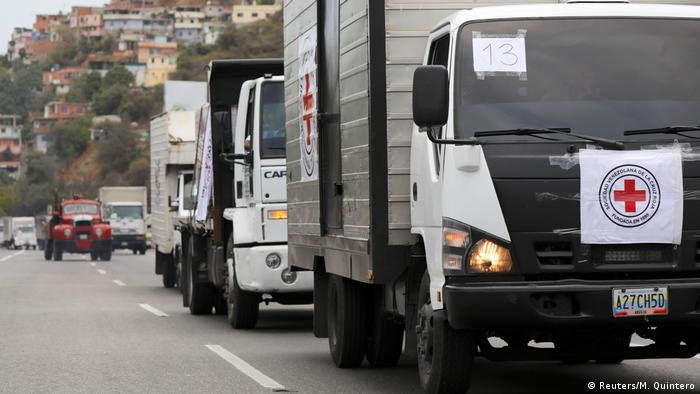 Trucks bringing in Red Cross humanitarian aid into Caracas