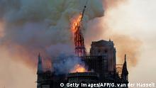 The steeple and spire engulfed in flames collapses as the roof of the Notre-Dame de Paris Cathedral burns on April 15, 2019 in Paris. - A colossal fire swept through the famed Notre-Dame Cathedral in central Paris on April 15, 2019, causing a spire to collapse and raising fears over the future of the nearly millenium old building and its precious artworks. The fire, which began in the early evening, sent flames and huge clouds of grey smoke billowing into the Paris sky as stunned Parisians and tourists watched on in sheer horror. (Photo by Geoffroy VAN DER HASSELT / AFP) (Photo credit should read GEOFFROY VAN DER HASSELT/AFP/Getty Images)