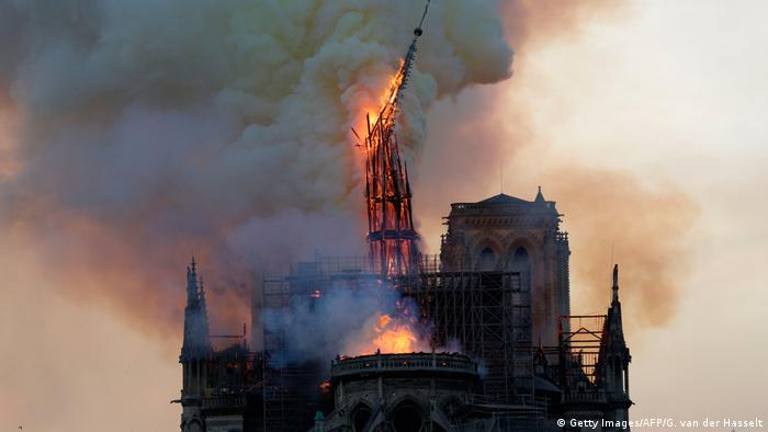 The collapsing spire and roof of Paris' Notre Dame Cathedral engulfed in flames on April 15, 2019