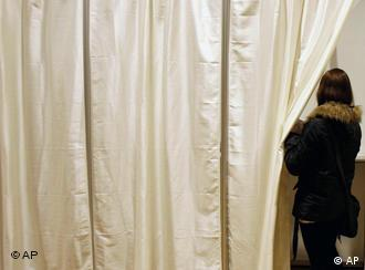 A Icelandic woman seen entering a polling booth