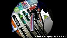 A petrol pump is seen at a petrol station in Lisbon 21 April 2006. World oil prices struck fresh historic peaks above 73,0 dollars in London and close to 72,0 dollars in New York. Oil prices climbed for the third straight record-setting day, as the market digested a US. government report that showed shrinking gasoline supplies and weakening demand for motor fuel. (Photo credit should read NICOLAS ASFOURI/AFP/Getty Images)