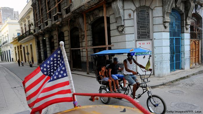 A US flag is seen on a Havana street as people ride a cycle taxi in the background in this January 17 file photo (Getty Images/AFP/Y. Lage)