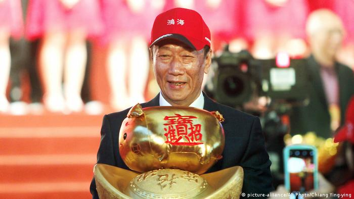 Terry Gou, chairman of Hon Hai Precision Industry Co. Ltd., also known as Foxconn, holds New Year's lucky charm during the company's annual carnival for employees in Taipei, Taiwan