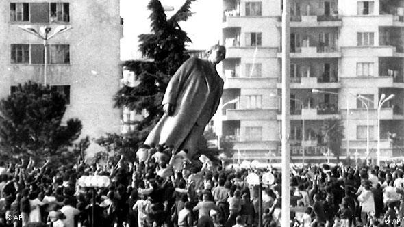 A statue toppled by an angry crowd