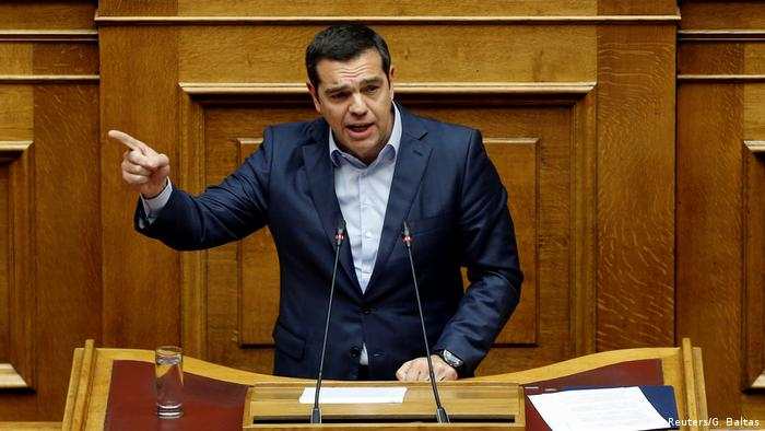 Greek Prime Minister Alexis Tsipras points a finger during a debate on wartime reparations