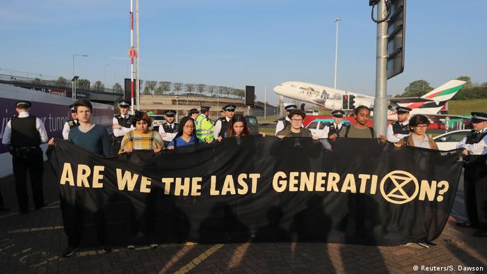 Protesters at Heathrow hold a banner reading 'Are we the last generation?'