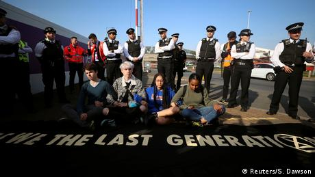 Climate change activists attend an Extinction Rebellion protest outside Heathrow Airport in London (Reuters/S. Dawson)