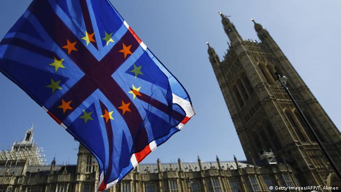 EU and British flags fly near the Houses of Parliament in London