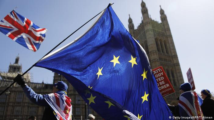 Protesters wave EU flags outside Parliament