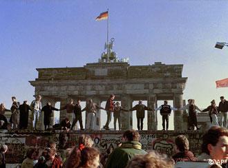 Berliners celebrate at the Brandenburg Gate in November, 1989