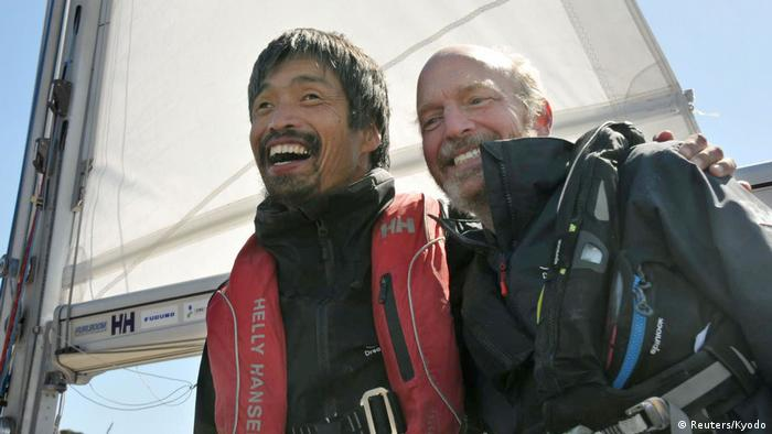 Mitsuhiro Iwamoto celebrates with his navigator Doug Smith after successfully crossing the Pacific. (Reuters/Kyodo)