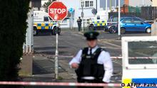 Police secure the area where a journalist was fatally shot amid rioting overnight in the Creggan area of Derry (Londonderry) in Northern Ireland