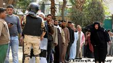 People stand in line to cast their vote during the referendum on draft constitutional amendments, at a polling station in Cairo, Egypt April 20, 2019. REUTERS/Mohamed Abd El Ghany
