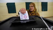 A woman casts her vote during the referendum on draft constitutional amendments, at a polling station in Cairo, Egypt April 20, 2019. REUTERS/Mohamed Abd El Ghany