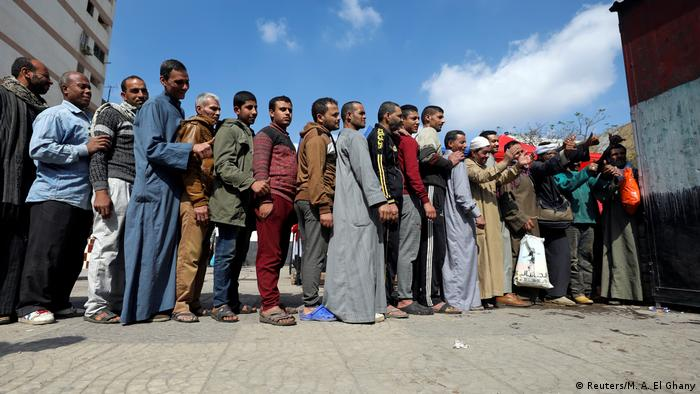 Voters stand in line in Cairo