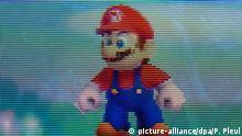 Die Hauptfigur des Videospiels «Super Mario» ist auf einem Nintendo 3DS zu sehen, fotografiert am 08.09.2015 in Sieversdorf (Brandenburg). Super Mario Bros. ist ein Jump-_n_-Run-Videospiel des japanischen Unternehmens Nintendo. Foto: Patrick Pleul/dpa | Verwendung weltweit