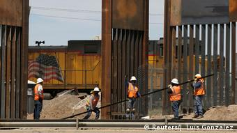 Workers build the border wall between the US and Mexico