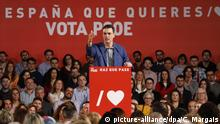 Socialist PM Pedro Sanchez speaks to supporters at a campaign rally