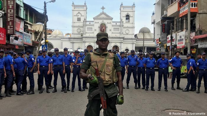 Sri Lankan security forces guard St. Anthony's church after Sunday bombings