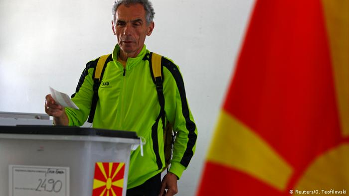 A man votes in North Macedonia's presidential election