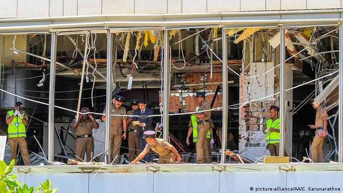 Security forces inspect the scene after a blast targeting the Shangri-La Hotel in Colombo