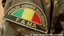 Detail of the badge of a member of the Malian Army (Fama), in Anderamboukane, in Menaka region, on March 22, 2019. (Photo by Agnes COUDURIER / AFP) (Photo credit should read AGNES COUDURIER/AFP/Getty Images)