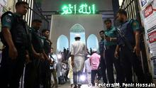Security personnel stand guard at the entrance of the Baitul Mukarram National Mosque as security has been increased after the series of Sri Lanka attacks, in Dhaka, Bangladesh April 21, 2019. REUTERS/Mohammad Ponir Hossain