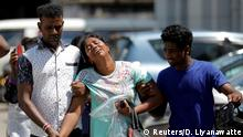 Relatives of victims react at a police mortuary following bomb blasts in Colombo (Reuters/D. Liyanawatte)