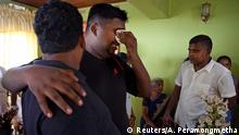 Friends and relatives mourn for Mary Noman Shanthi, 58, and Rohan Marselas Wimanna, 59, who died as bomb blasts ripped through churches and luxury hotels on Easter, in Negombo