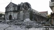 The St. Catherine church is damaged after an earthquake struck Porac town, Pampanga province, northern Philippines Monday, April 22, 2019. A strong 6.1 magnitude earthquake in the north Philippines on Monday trapped some people in a collapsed building, damaged an airport terminal and knocked out power in at least one province, officials said. (AP Photo/Vhic Y Naluz) |