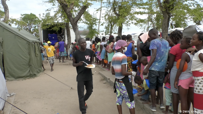 Residents in Beira line up in a make-shift camp for food rations
