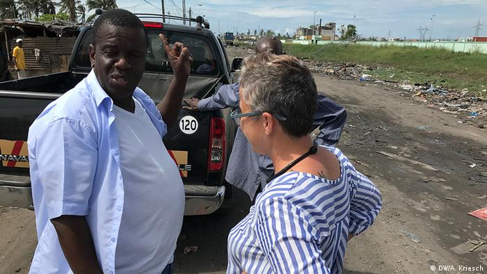 The mayor of Beira talks to a woman as he inspects the damage in the city