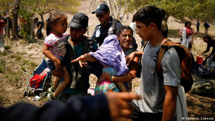 A Central American famiy is detained by Federal Policemen during an immigration raid in their journey towards the United States