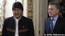 Bolivian President Evo Morales (L) and his Argentinian counterpart Mauricio Macri arrive for a press conference before a working meeting at Casa Rosada presidential palace in Buenos Aires on April 22, 2019. (Photo by JUAN MABROMATA / AFP)