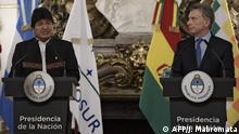 Bolivian President Evo Morales (L) speaks next to his Argentinian counterpart Mauricio Macri during a press conference before a working meeting at Casa Rosada presidential palace in Buenos Aires on April 22, 2019. (Photo by JUAN MABROMATA / AFP)