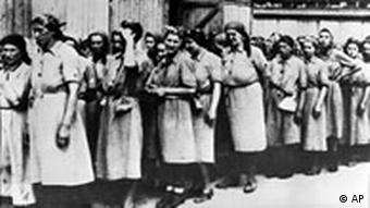 Women prisoners line up for a hard labor assignment at the Auschwitz concentration camp