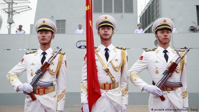 China parades new warship as navy celebrates 70th anniversary