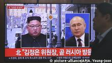 A man passes by a TV screen showing images of North Korean leader Kim Jong Un, left, and Russian President Vladimir Putin, right, during a news program at the Seoul Railway Station in Seoul, South Korea, Tuesday, April 23, 2019. North Korea confirmed Tuesday that Kim will soon visit Russia to meet with Putin in a summit that comes at a crucial moment for tenuous diplomacy meant to rid the North of its nuclear arsenal. The screen reads: Kim Jong Un visits Russia soon. (AP Photo/Ahn Young-joon) |