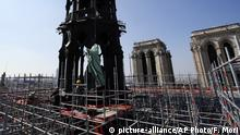 11.04.2019 +++ The religious statue representing St. Andrew perched atop Paris' Notre Dame Cathedral descends to earth for the first time in over a century as part of a restoration, in Paris Thursday, April 11, 2019. The 16 greenish-gray copper statues, which represent the twelve apostles and four evangelists, are lowered by a 100 meter (105 yard) crane onto a truck to be taken for restoration in southwestern France. (AP Photo/Francois Mori) |