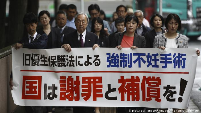 Members of the defense team and supporters for a man who claims he was forcibly sterilized enter the Sendai District Court to file a lawsuit in Sendai, Miyagi Prefecture on May 17, 2018