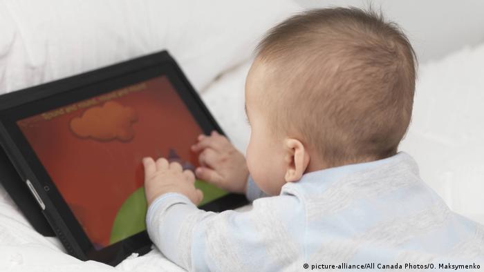 Baby with an Apple iPad