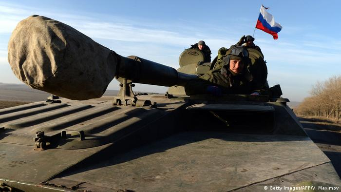 Pro-Russia militants in the Donetsk region in a tank