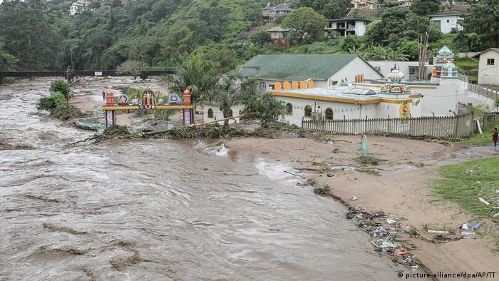 Floodwaters wash through a property near Durban, South Africa