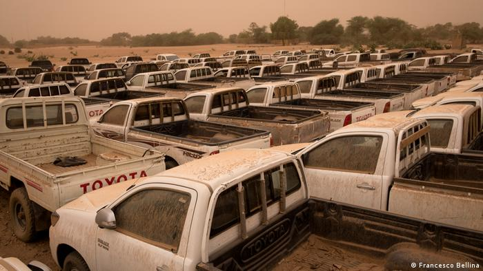 Rows of pickups confiscated from smugglers